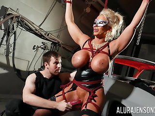 Bound cock floosie Alura Jenson is toyed with by a stranger adjacent to a dungeon