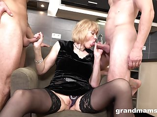 Beneficent nurturer enjoys prime time threesome sex near two young men