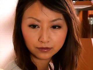 Hairy asian plays there her hairy pussy