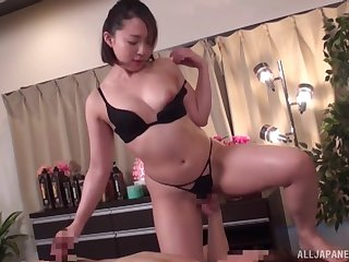 Passionate fucking on rub-down the massage directorship close to a obese Japanese girl